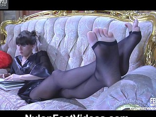 Skinny-legged gal in darksome sandal toe hose gives a peculiar nylon footjob