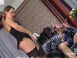 Maid in designer nylons with the addition of a lacy corset luring her taskmaster into a fuck