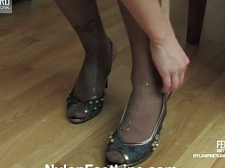 Lascivious French maid in smooth tights willingly brawny smashing footjob