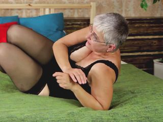 Don't be surprised! Old women desires to feel hot every now and then too! Granny wears stockings and daring underclothes while she feels herself in bed. She proceeds to play with her saggy boobs and her aging pussy which badly needs a rod inside of it! If Granny can only find a man for herself!