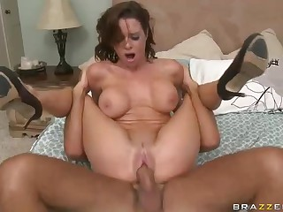 Large breasted cougar Veronica Avluv calls for technician to fix her computer and her pussy too. She sucks big cock with her pink blouse on and then rides it naked in the middle of the bed.