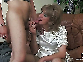Dolled-up sissy guy in a striking white satin dress willing to be gazoo robbed