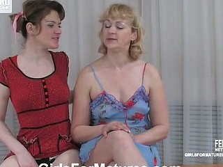 Wicked ponytailed girlie fondling mellow older boobs in advance of strap-on action