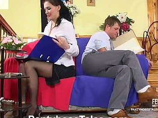 Female co-worker in black tights wetting 10-Pounder previous to taking it up her vagina