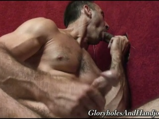 Gay hunk jerks during the time that engulfing cock