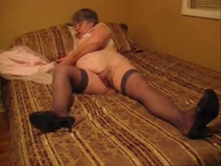 Fat granny fucks her twat with toy