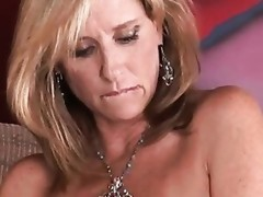 Breasty cougar Jodi West uses a sex toy to fill her wet crack hole